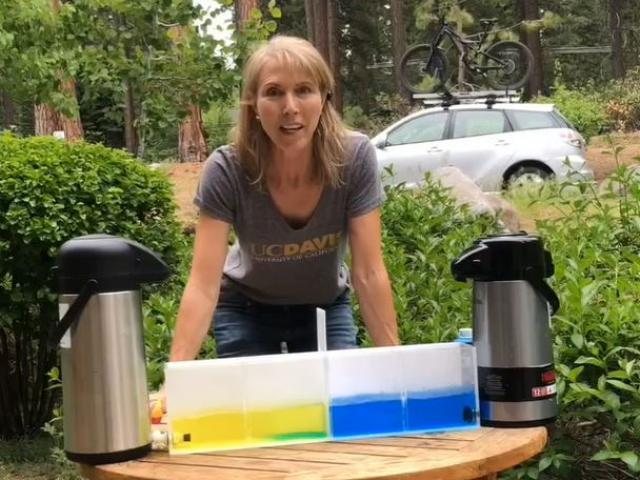 researcher demonstrating water research in Tahoe
